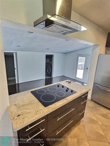 Photo of 1444 Lauderdale Villa Dr, Fort Lauderdale, FL 33311 (MLS # F10284824)