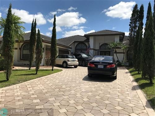 Photo of 12056 SW 1st St, Coral Springs, FL 33071 (MLS # F10223825)