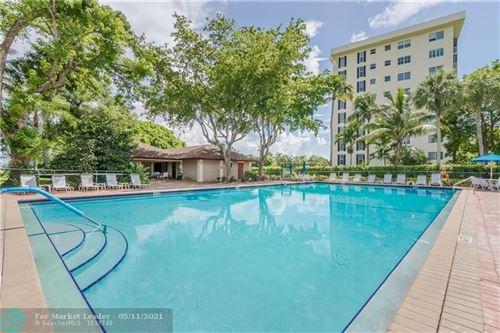 Photo of 3300 N Palm Aire Dr #105, Pompano Beach, FL 33069 (MLS # F10283828)