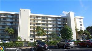 Photo of 2430 Deer Creek Country Club Blvd #103, Deerfield Beach, FL 33442 (MLS # F10193831)