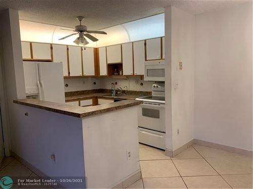 Photo of 10913 W Clairmont Cir #104, Tamarac, FL 33321 (MLS # F10305834)