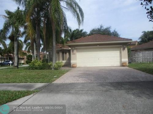Photo of 4139 Oxbow Dr, Coconut Creek, FL 33073 (MLS # F10217838)