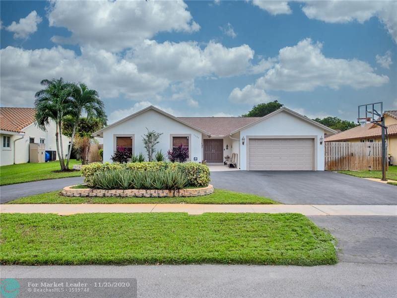 Photo of 9590 NW 17th St, Plantation, FL 33322 (MLS # F10259840)