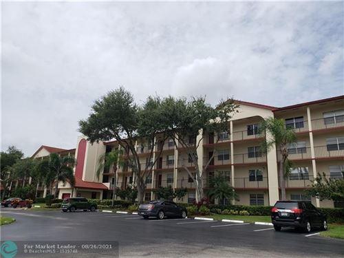 Photo of 901 SW 128th Ter #A 301, Pembroke Pines, FL 33027 (MLS # F10297852)
