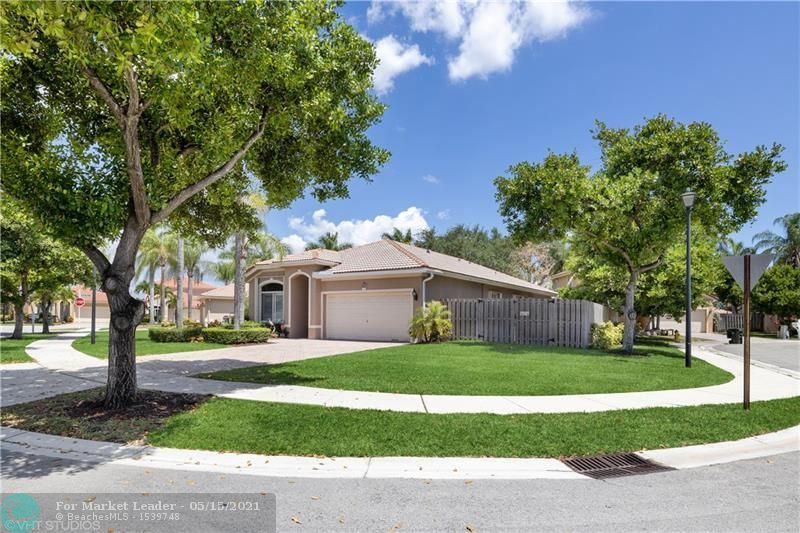 Photo of 4129 Oxbow Dr, Coconut Creek, FL 33073 (MLS # F10283862)
