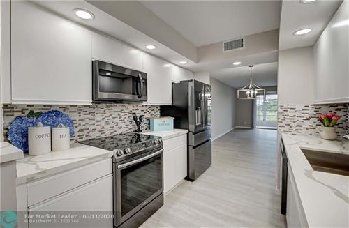 Photo of 1606 Abaco Dr #D4, Coconut Creek, FL 33066 (MLS # F10237863)