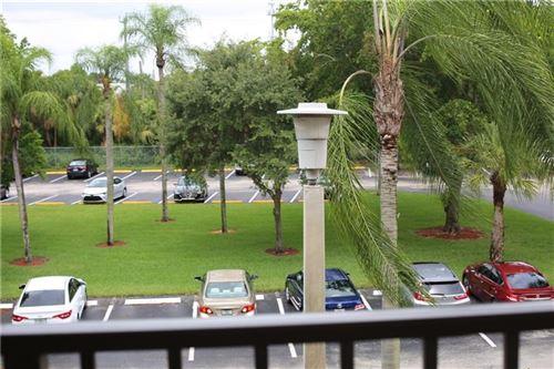 Photo of 1201 SW 141st Ave #J307, Pembroke Pines, FL 33027 (MLS # F10232867)