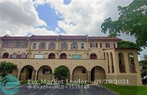 Photo of 3050 Riverside Dr #11-A, Coral Springs, FL 33065 (MLS # F10301870)