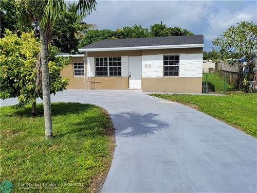 Photo of 5615 Hayes St, Hollywood, FL 33021 (MLS # F10303877)