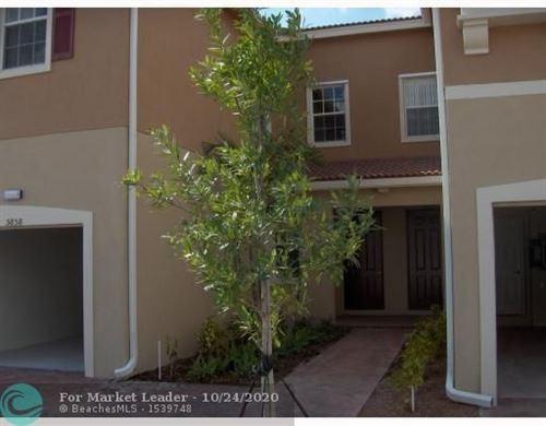 Photo of 5858 Hampton Hills Blvd #6104, Tamarac, FL 33321 (MLS # F10254879)