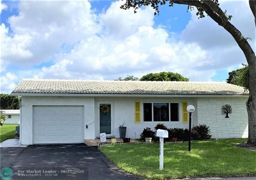 Photo of 8229 NW 13th St, Plantation, FL 33322 (MLS # F10234880)