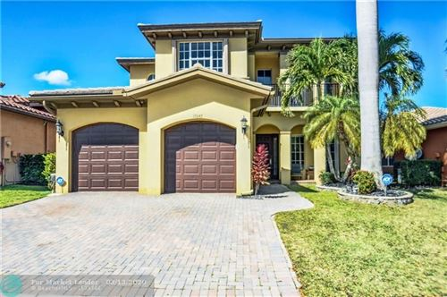 Photo of 10645 NW 83rd Ct, Parkland, FL 33076 (MLS # F10219881)