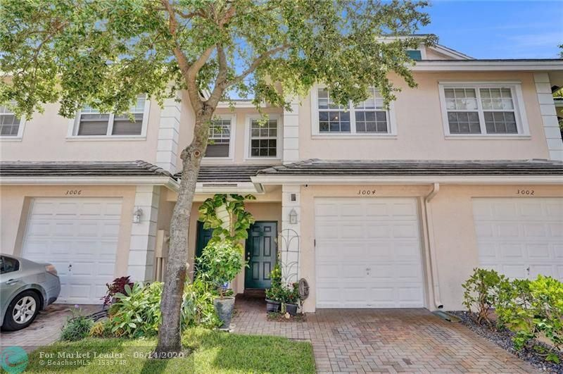 Photo of 3004 NW 30th Ave #3004, Oakland Park, FL 33311 (MLS # F10232883)