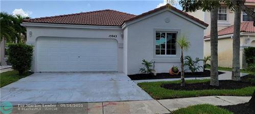 Photo of 15942 NW 21st St, Pembroke Pines, FL 33028 (MLS # F10300884)