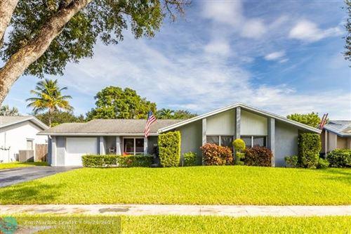 Photo of 10461 SW 51st St, Cooper City, FL 33328 (MLS # F10301884)