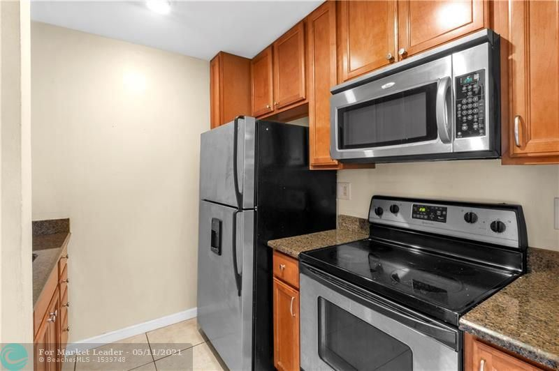 Photo of 4126 NW 88th Ave #201, Coral Springs, FL 33065 (MLS # F10283885)