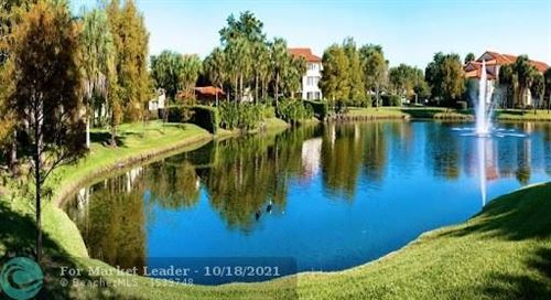 Photo of 10749 Cleary Blvd #211, Plantation, FL 33324 (MLS # F10304895)