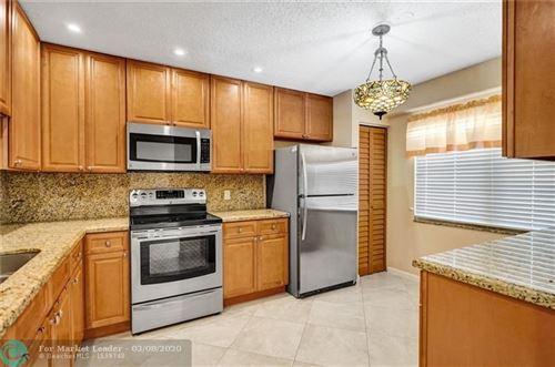 Photo of 700 SW 128th Ave #407C, Pembroke Pines, FL 33027 (MLS # F10219896)