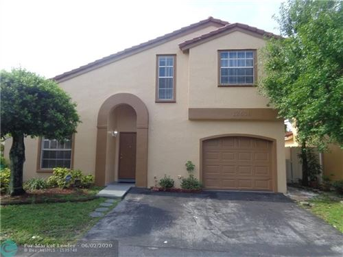 Foto de inmueble con direccion 12638 NW 12th Ct Sunrise FL 33323 con MLS F10231896