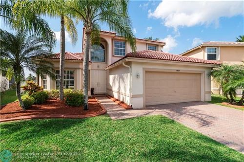 Photo of 4858 NW 117th Ave, Coral Springs, FL 33076 (MLS # F10223898)
