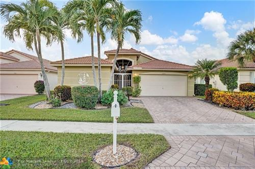 Photo of 10575 Tropical Breeze Ln, Boynton Beach, FL 33437 (MLS # F10206900)