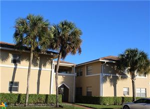Photo of 1020 SW Twin Lakes Dr, Coral Springs, FL 33071 (MLS # F10109904)