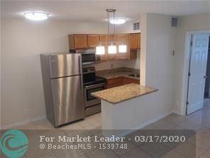 Photo of 824 NE 17th Terrace #8, Fort Lauderdale, FL 33304 (MLS # F10221904)