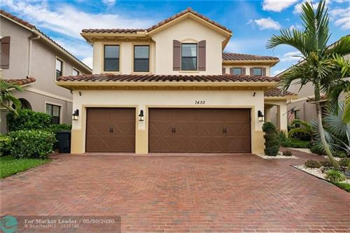 Photo of 7430 NW 108th Ave, Parkland, FL 33076 (MLS # F10230908)
