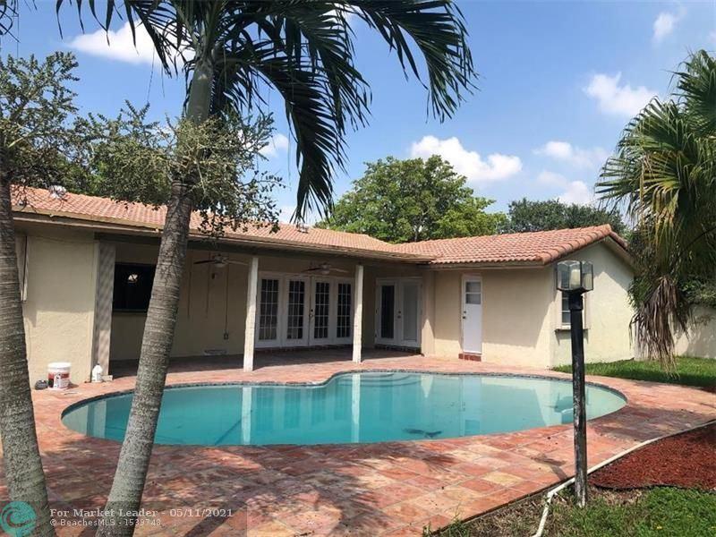 Photo of 969 Ramblewood Dr, Coral Springs, FL 33071 (MLS # F10283908)