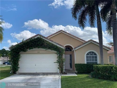 Photo of 1664 Carriage Brooke Dr, Wellington, FL 33414 (MLS # F10241909)