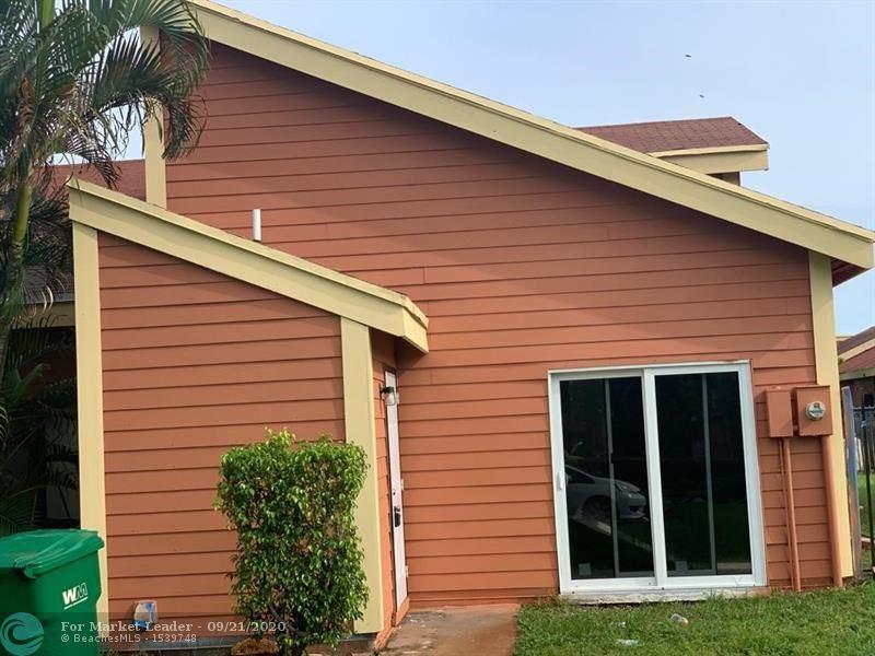 Photo of 5509 NW 24th St #5509, Lauderhill, FL 33313 (MLS # F10249910)