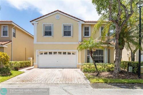 Photo of 1120 Satinleaf St, Hollywood, FL 33019 (MLS # F10263911)