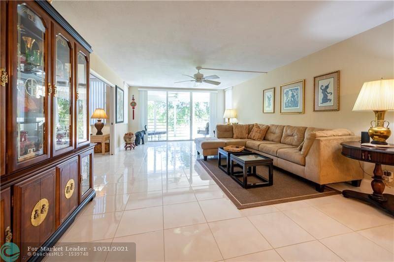 Photo of 804 Cypress Grove Ln #302, Pompano Beach, FL 33069 (MLS # F10304911)