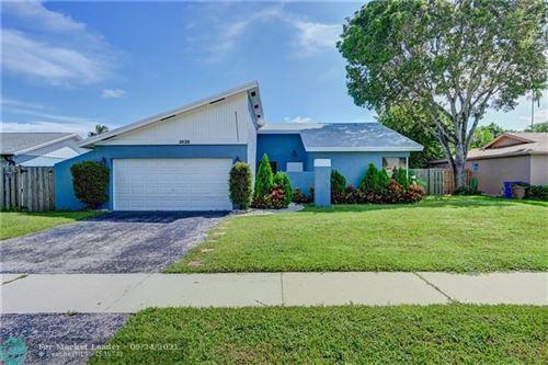 Photo of 3928 NW 2nd Ct, Deerfield Beach, FL 33442 (MLS # F10301912)
