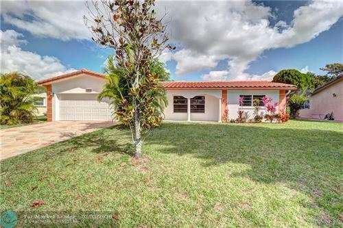 Photo of 11041 NW 43rd Ct, Coral Springs, FL 33065 (MLS # F10222917)