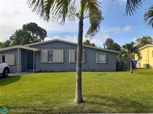 Photo of 4401 NW 59th Ct, Fort Lauderdale, FL 33319 (MLS # F10230917)
