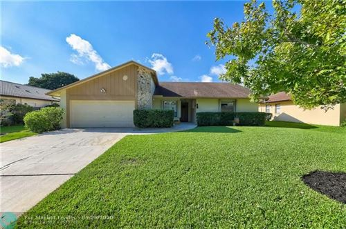 Photo of 7018 NW 39th St, Coral Springs, FL 33065 (MLS # F10250917)