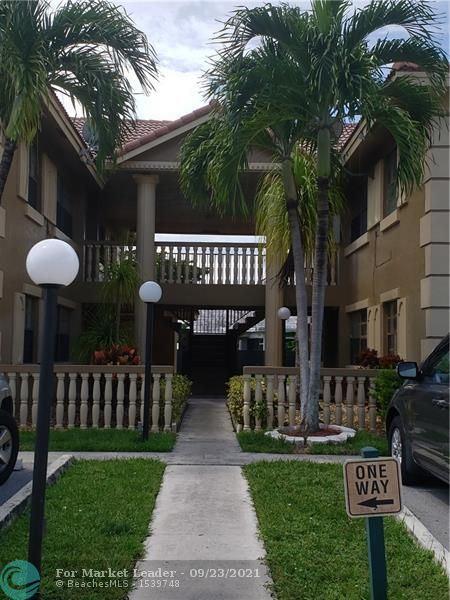Photo of 2646 Riverside Dr #2646, Coral Springs, FL 33065 (MLS # F10301918)