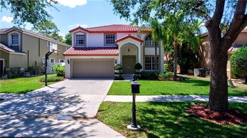Photo of 6101 NW 58th Way, Parkland, FL 33067 (MLS # F10278920)