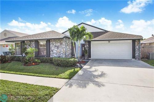 Photo of 21081 Woodspring Ave, Boca Raton, FL 33428 (MLS # F10305923)