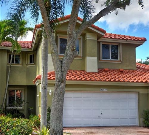 Photo of 12577 NW 57th Pl, Coral Springs, FL 33076 (MLS # F10282925)