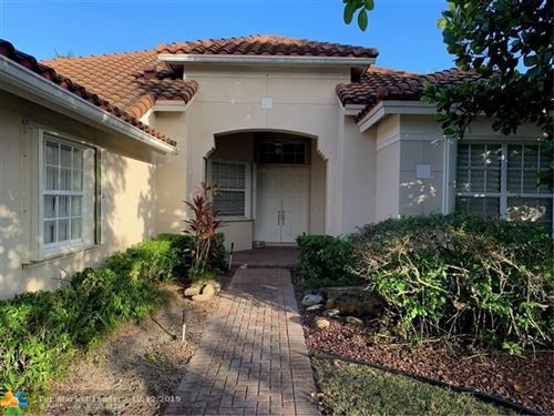Photo of 7026 NW 113th Ave, Parkland, FL 33076 (MLS # F10206927)