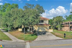 Photo of 5410 NW 60th Dr, Coral Springs, FL 33067 (MLS # F10167930)