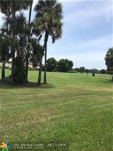 Photo of 2420 Deer Creek Country Club Blvd #108D, Deerfield Beach, FL 33442 (MLS # F10135931)