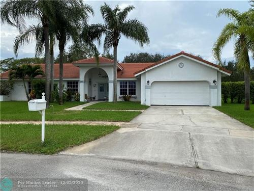 Photo of 710 NW 201st Ave, Pembroke Pines, FL 33029 (MLS # F10260931)