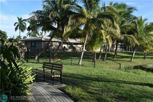 Photo of 921 E Tropical Way, Plantation, FL 33317 (MLS # F10252934)
