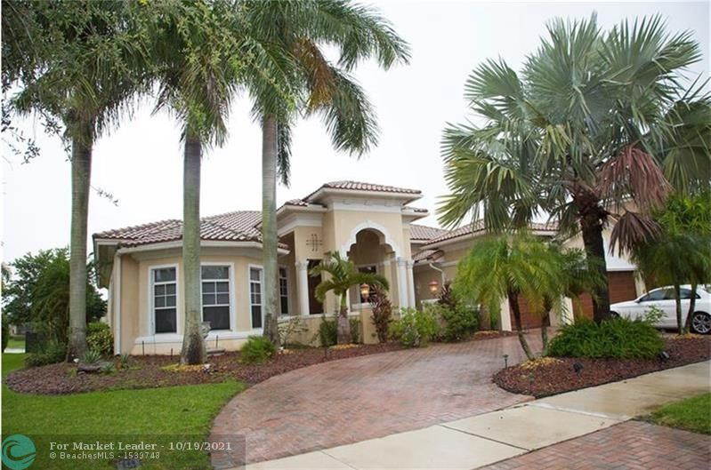 Photo of 6818 NW 117th Ave, Parkland, FL 33076 (MLS # F10304934)