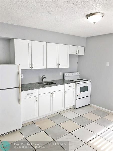 Photo of 4030 NW 30th Ter #4, Lauderdale Lakes, FL 33309 (MLS # F10249935)