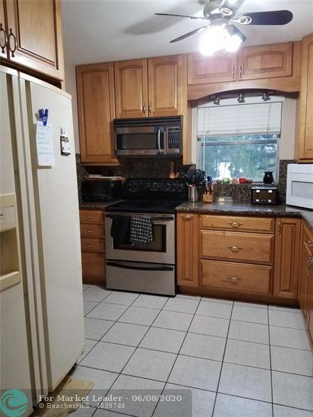 Photo of 5620 SW 55th Ave, Davie, FL 33314 (MLS # F10232943)