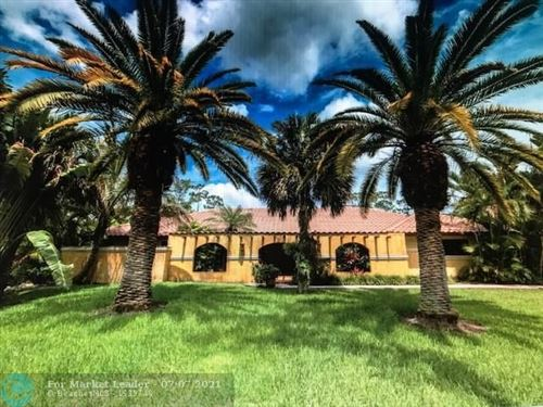 Photo of 6004 NW 65th Ter, Parkland, FL 33067 (MLS # F10290944)